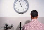 getty_rf_photo_of_man_at_urinal_by_clock