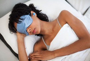 getty_rf_photo_of_woman_sleeping_in_mask_and_earplugs